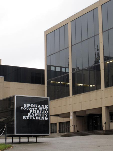 "Building with large glass windows, with a sign reading, ""Spokane County-City Public Safety Buildi"
